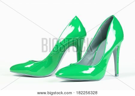 Lacquered shiny green shoes high heels on white background.