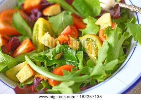 Mixed greens salad with miniature heirloom tomatoes and croutons
