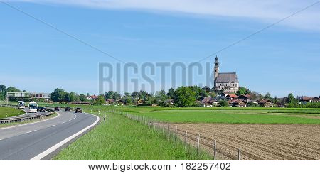 Parish Catholic Church of Assumption of the Blessed Virgin Mary in Bavarian small town Anger near highway