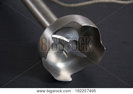 a detail of a silver blender on black background