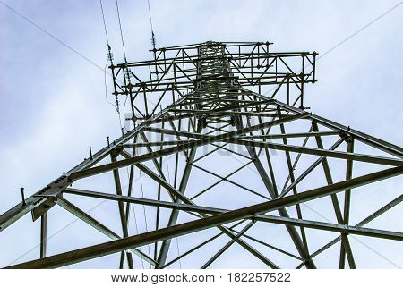 Support for power transmission lines by air. Against the sky