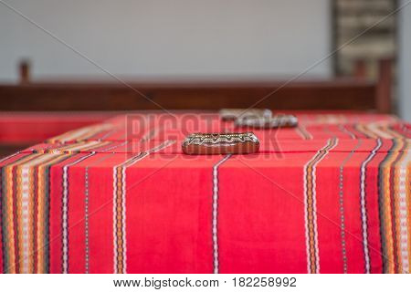 Table with traditional Bulgarian tablecloth in restaurant