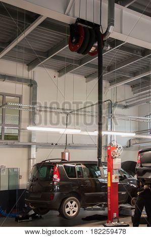 Modern automobile service station with fumes exhaust vetillation unit