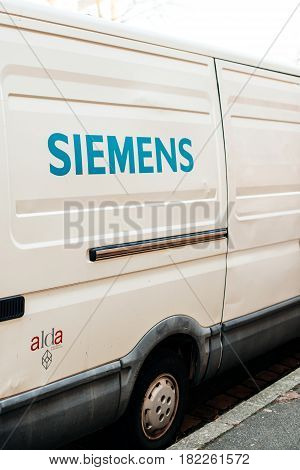 STRASBOURG FRANCE - FEB 13 2017: Rear view of white van from Siemens corporation parked on a street. Siemens AG is a German conglomerate company headquartered in Berlin and Munich and the largest manufacturing and electronics company in Europe with branch