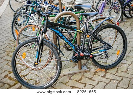 STRASBOURG FRANCE - FEB 13 2017: Modern BTWIN bike parked in city center parking - B'Twin ins a brandy by Decathlon is one of the world's largest sporting goods retailers.