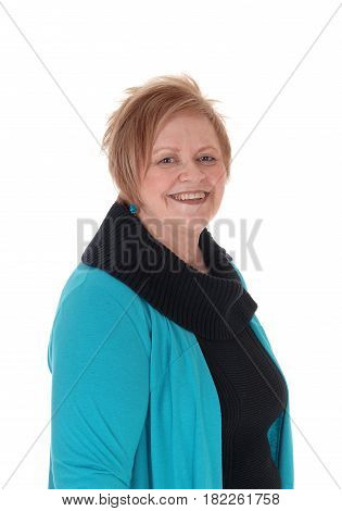 A closeup portrait of a happy smiling senior citizen woman wearing a turquoise jacket isolated for white background.