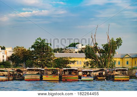 Bangkok, Thailand - January 9, 2016: Parking of tourist ships and boats near bank of Chao Phraya river in Bangkok, Thailand.