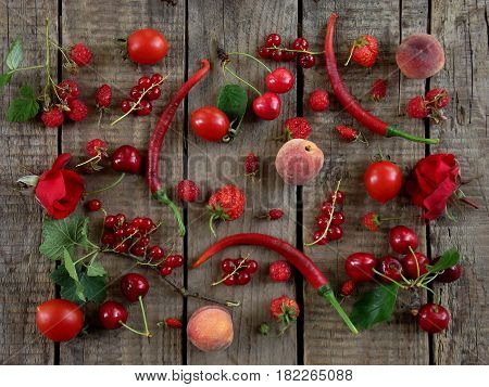 Red Fruits, Vegetables And Flowers On Wooden Background - Currants, Raspberries, Strawberries, Straw