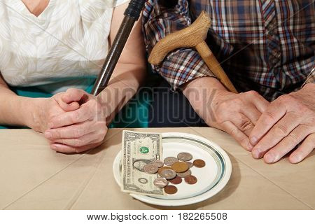 Poverty. Old Couple And Small Coin.