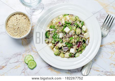 Cucumber quinoa Feta salad on a stone background