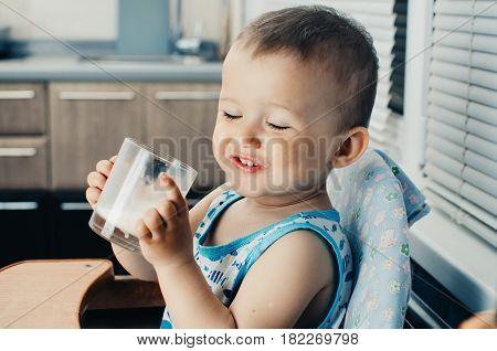 Beautiful Little Boy Drinking Milk