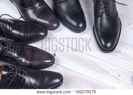 Male fashion with shoes on white wooden background