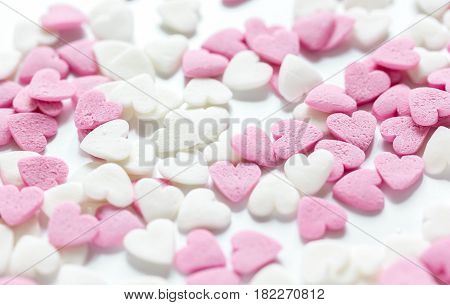 Delicious sugar lollipops and heartshaped candys on abstract candy background pattern