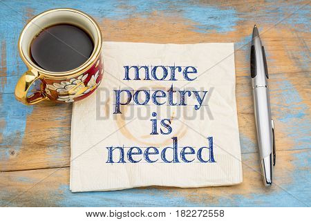 more poetry is needed -  handwriting on a napkin with a cup of coffee