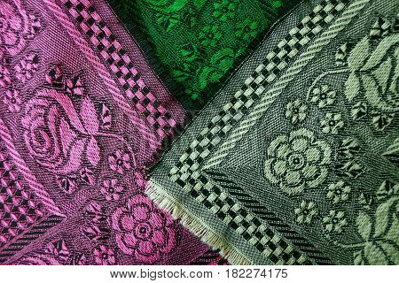 Texture of a fabric with a pattern and colors from woolen scarves