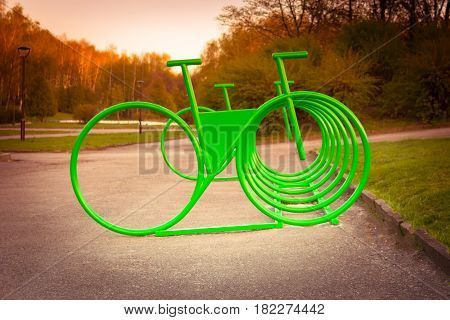 Parking space for bicycles outside in the park on spring day