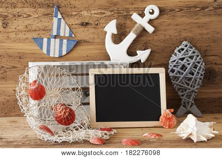 Blackboard With Nautical Summer Decoration And Wooden Background. Copy Space For Advertisement Or Free Text. Fish, Anchor, Shells And Fishnet For Maritime Contex.
