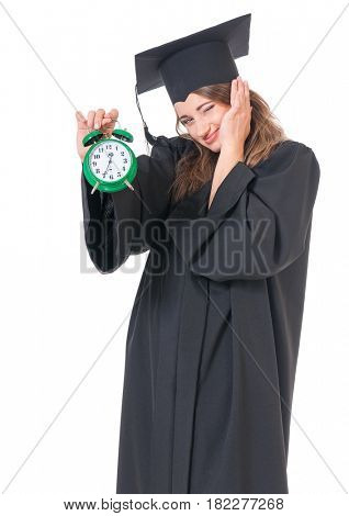 Young graduate girl student in mantle with alarm clock, isolated on white background