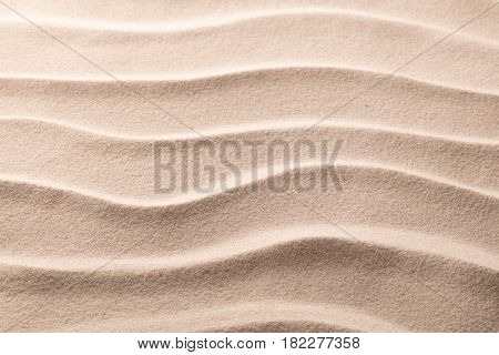 ripples in the beack sand, pattern of rippled lines texture background.