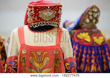 Bright Russian national costume for women with decoration and ornament