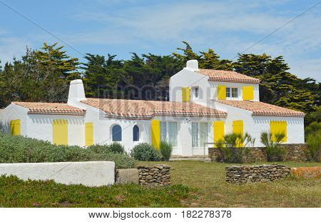Whitewashed typical house on oceanfront in France
