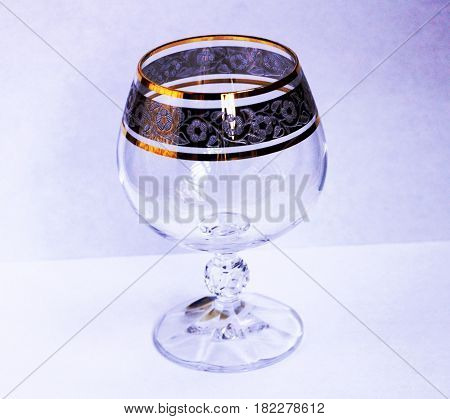 A glass with a gilded border in the form of a decorative pattern. Crystal.