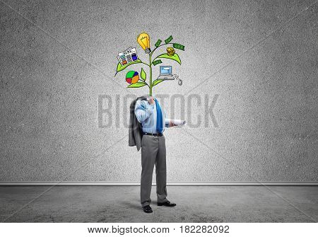 Faceless businessman in room with drawn growth concept instead of head
