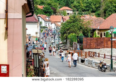 KARLSTEJN CZECH REPUBLIC - SEPTEMBER 03 2016: Main village street leading to Karlstejn Castle. Karlstejn Village Central Bohemia Czech Republic.