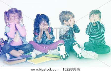 Group of little kids playing peek-a-boo together