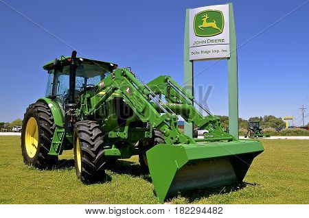 OAK RIDGE, LOUISIANA, April 8, 2017:  The 6120E John Deere tractor is a product of  product of John Deere Co, an American corporation that manufactures agricultural, construction, forestry machinery, diesel engines, and drive trains