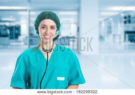 Young nurse with stethoscope standing and looking syringe in hand. Concept medical and Healty.