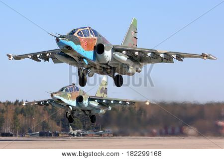 KUBINKA, MOSCOW REGION, RUSSIA - MAY 3, 2015: Pair of Sukhoi SU-25 military aircrafts of Russian Air Force preparing for Victory Day parade at Kubinka air force base.