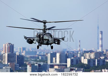 LYUBERTSY, MOSCOW REGION, RUSSIA - JULY 12, 2011: Kamov Ka-52 Alligator attack helicopter pictured over Moscow city in Lyubertsy.