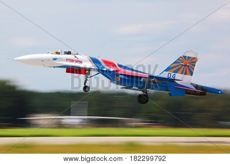 KUBINKA, MOSCOW REGION, RUSSIA - MAY 28, 2011: Sukhoi Su-27 jet fighter taking off at Kubinka air force base.