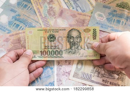 100,000 dong of Vietnamese banknote with Vietnamese banknote background.