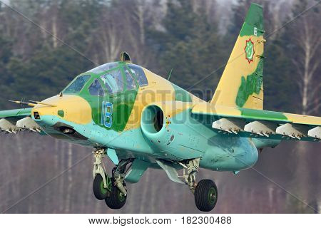 KUBINKA, MOSCOW REGION, RUSSIA - FEBRUARY 28, 2015: Sukhoi Su-25UB of Turkmenistan air force landing at Kubinka air force base.