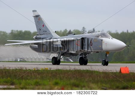 KUBINKA, MOSCOW REGION, RUSSIA - MAY 18, 2015: Sukhoi SU-24 RF-92245 bomber of Russian Air Force taxiing at Kubinka air force base.