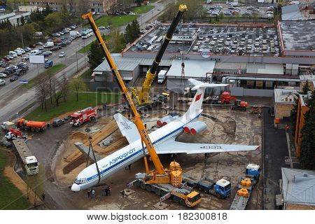 SHEREMETYEVO, MOSCOW REGION, RUSSIA - APRIL 29, 2015: Ilyushin IL-62M RA-86492 putting on a plinth with kranes at Sheremetyevo international airport.