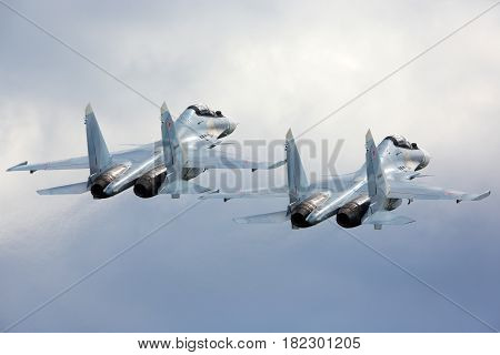 KUBINKA, MOSCOW REGION, RUSSIA - JUNE 17, 2015: Pair of Sukhoi Su-30SM RF-91815 jet fighters take off at Kubinka air force base during Army-2015 forum.