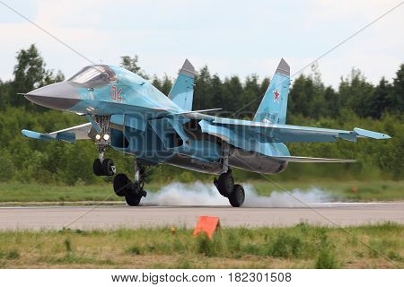 KUBINKA, MOSCOW REGION, RUSSIA - JUNE 22, 2015: Sukhoi SU-34 RF-92252 of russian air force bomber landing at Kubinka air force base during Army-2015 forum