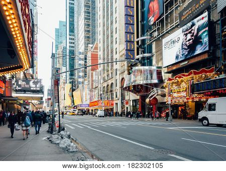 New York City USA - March 21 2017: 42nd street has many tourist attractions as well as multiplex cinemas restaurant fast food and shops.