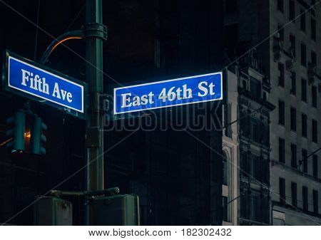 Street sign of Fifth Ave and East 41St with skylines in background.- New York USA