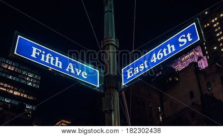 Street sign of Fifth Ave and East 41St with skylines in background.- New York USA poster
