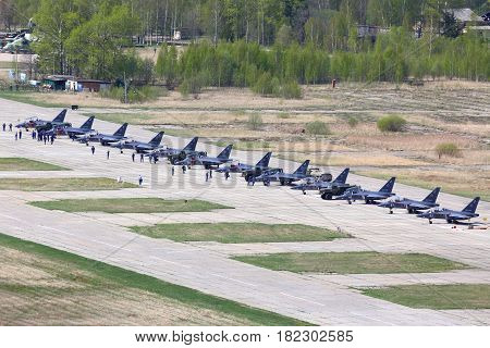 KLIN, MOSCOW REGION, RUSSIA - MAY 9, 2015: Line of brand new Yakovlev Yak-130 military jets standing at Klin air force base on a Victory Day.