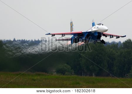 KUBINKA, MOSCOW REGION, RUSSIA - JUNE 19, 2015: Sukhoi Su-27 of Aerobatics team Russian Knights jet fighter takes off at Kubinka air force base during Army-2015 forum