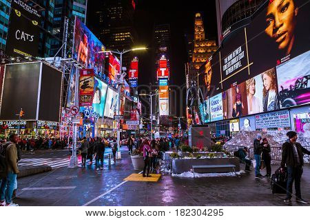 New York City USA- March 18 2017: Times Square featured with Broadway Theaters and animated colorful LED signs stores and lots of tourists and locals is a symbol of NYC and the USA in Manhattan.