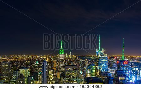Aerial view night panorama of New York City downtown with urban skyscrapers