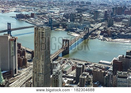 Aerial view of New York City with Manhattan skyscrapers and streets and Manhattan and Brooklyn bridge