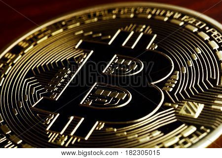 Golden  Bitcoin currency closeup -  business concept