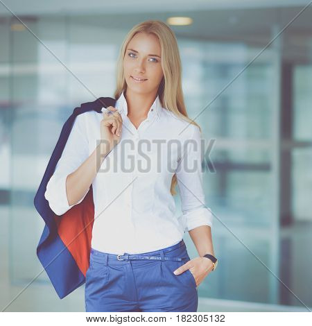 Young business woman standing in business center